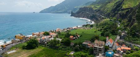 Small town at rough rocky beach coastline of green cape verde island