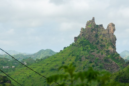 santiago cape verde: Green mountain top on cape verde island over mist clouds