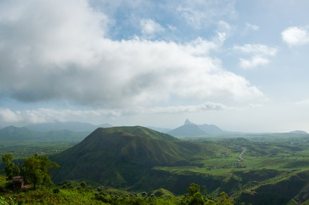 Green valley with hill in the middle under cloudy sky on Cape Verde island