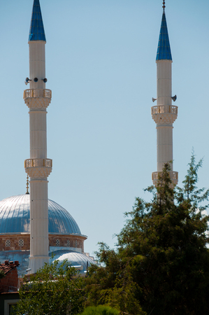 prayer tower: Small mosque with two towers and blue roofs in Pamukkale in turkey
