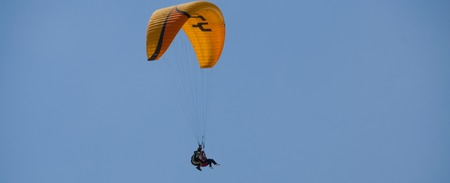 paraglide: Paraglide tandem with yellow parachute in the blue sky over Pamukkale in Turkey
