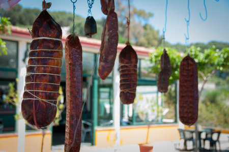 italian salami: Big italian salami sausage hanging on string in calabria, italy Stock Photo