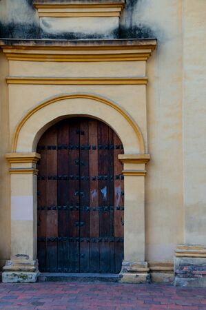 colonial building: Entrance of old colonial building with wood door in Bogota, Colombia Stock Photo