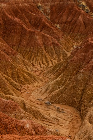 parch: Dry valley red orange sand stone rock formation in hot desert of Tatacoa, Huila in Colombia