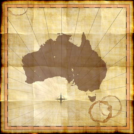 Australia map on old paper with coffee stains photo