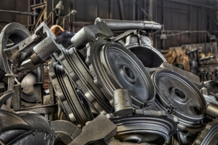 Stack of cast metal parts in a iron foundry photo