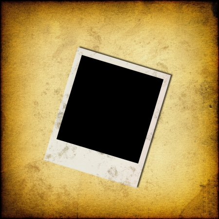 Blank instant photo frame on old grunge paper background photo