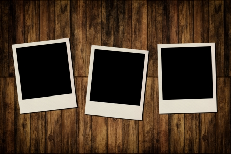 group picture: Blank instant photo frames on old wooden background