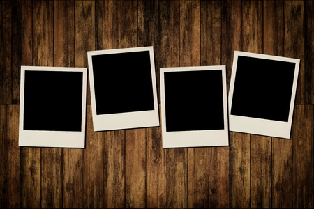 polaroid frame: Blank instant photo frames on old wooden background