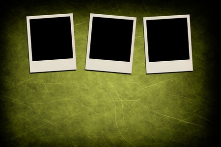 Blank instant photo frames on grunge green background photo