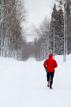 Man running in winter park photo