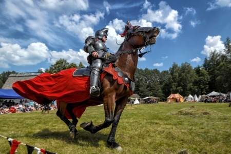 CHORZOW,POLAND, JUNE 9: Medieval knight on horseback during a IV Convention of Christian Knighthood on June 9, 2013, in Chorzow Editorial