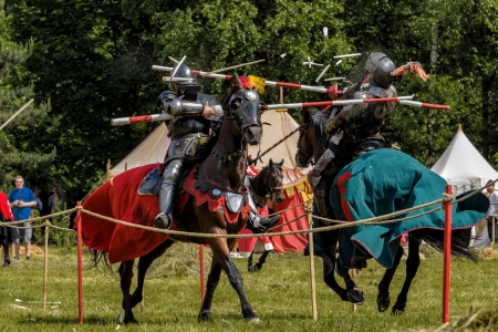jousting: CHORZOW,POLAND, JUNE 9: Medieval knights jousting during a IV Convention of Christian Knighthood on June 9, 2013, in Chorzow Editorial