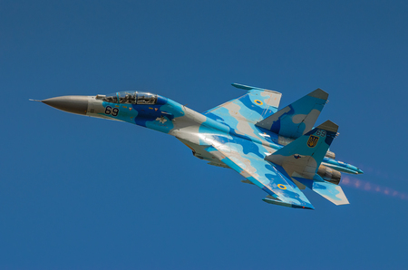 RADOM, POLAND - AUGUST 25: Ukrainian SU-27 display during Air Show 2013 event on August 25, 2013 in Radom, Poland