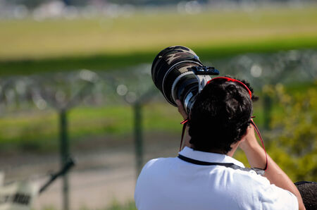 telezoom: Photographer with camera