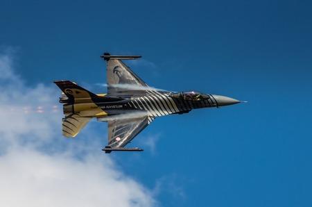 lockheed martin: RADOM, POLAND - AUGUST 25: Turkish F-16 Falcon - Soloturk Display Team during Air Show 2013 event on August 25, 2013 in Radom, Poland