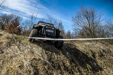 dirt road recreation: OGRODZIENIEC, POLAND - March 19. Off-road Penrite H6 4x4 competition on March 19, 2016 in Ogrodzieniec, Poland