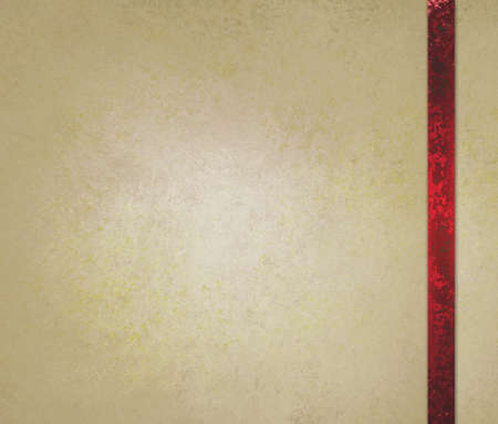 neutral beige or off white background with red ribbon trim accent photo