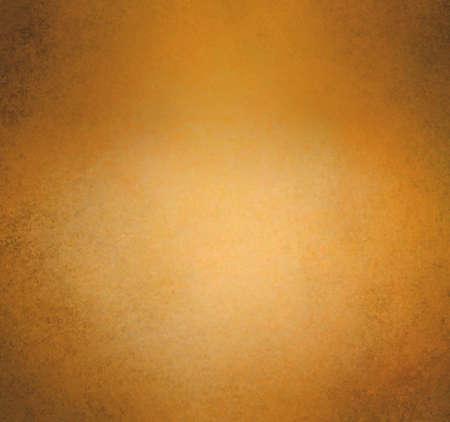 burnished: burnt golden orange background, vintage worn distressed border texture, gold orange wall paint with darker black grunge border and bright copper color spotlight center, old paper texture