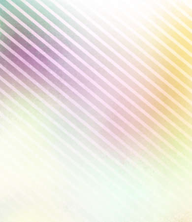 faded: soft faded yellow pink and green background with stripes in diagonal pattern and faint texture Stock Photo