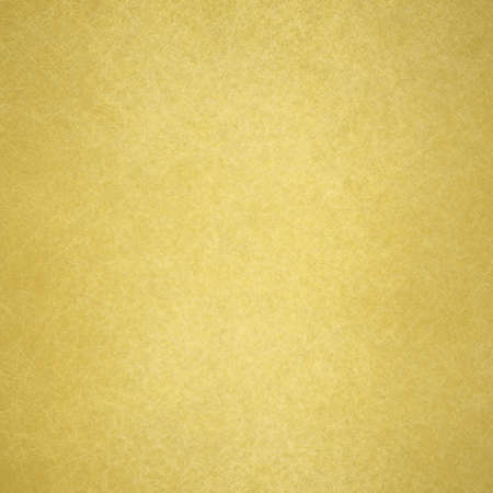 gold background poster, texture is old vintage distressed solid gold color with rough peeling paint Stock Photo
