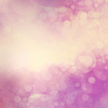yellowed: yellowed purple and white bokeh background, faded cloudy white lights sparkling in the sky. Fantasy background design. Stock Photo