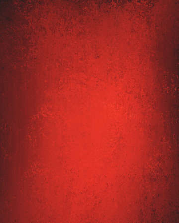 red paint: plain elegant red background with slight faded vintage sponge texture and dark edges and blank copyspace for Christmas ad or valentines day brochure Stock Photo