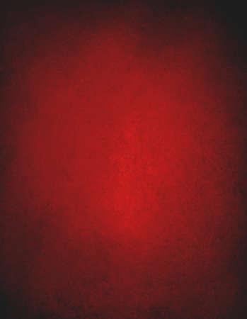 Red background. Christmas background. Black grunge textured border. Foto de archivo