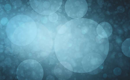 faded: blurred blue bokeh lights on blue background in faded soft vintage style Stock Photo