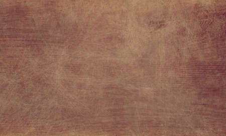 old paper background texture illustration with brown earthy color tones in parchment or document design that is simple, plain and has faint brown orange vintage grunge stains
