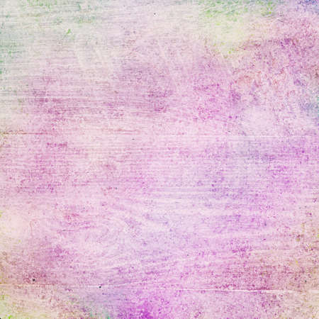 old faded colorful background design with wood lumber or board grain wall in white grunge texture, distressed grungy pastel colors of pink purple green and yellow Фото со стока