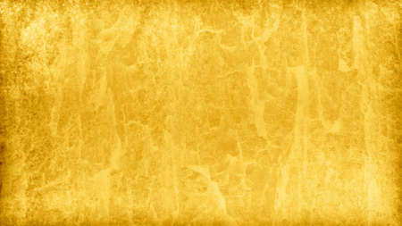 Gold background with marbled foil or painted metal texture design in a fancy luxury yellow pattern that is distressed and elegant Фото со стока