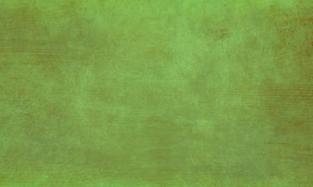 old green background texture with grunge and paint scratches and lines, vintage grungy wood board wall or floor  with textured detailed surface