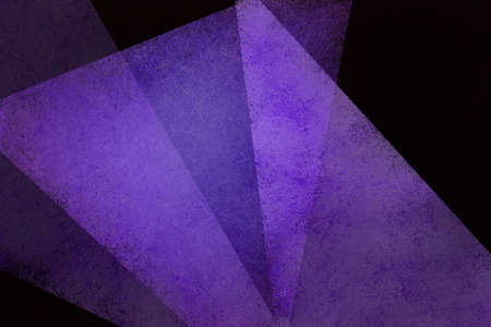 Abstract black background with purple triangle shapes and transparent texture 版權商用圖片