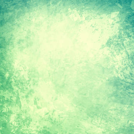 Faded green background with soft yellow center and old distressed vintage grunge texture on border