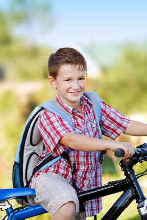 Young school boy on a bicycle Stock Photo - 5288841