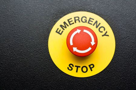 Red emergency button on black panel photo