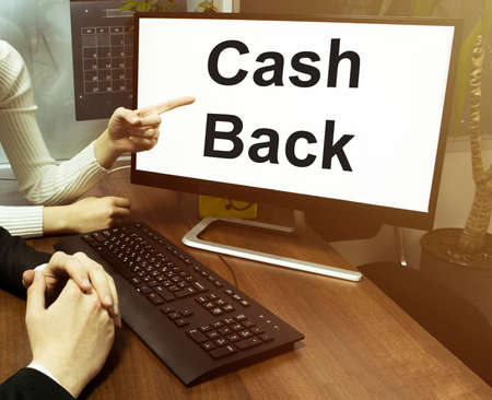 male and female hand, computer with text Cash Back with office background