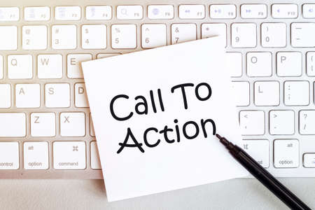 piece of paper with text Call To Action on the keyboard on a white background with a black felt-tip pen 免版税图像 - 151112548