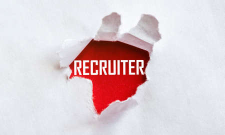 white torn paper with text RECRUITER on red background Banco de Imagens