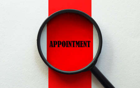 magnifier with text Appointment on the white and red background