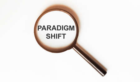 Paradigm Shift on a sheet under a magnifying glass Stock Photo