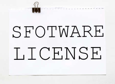 white paper with text Software License on a white background with stationery