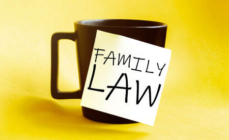 white paper with text Family Law on the black cup