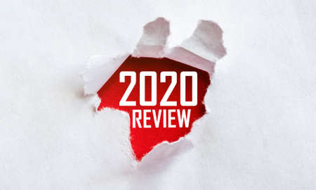 white torn paper with text 2020 Review on red background