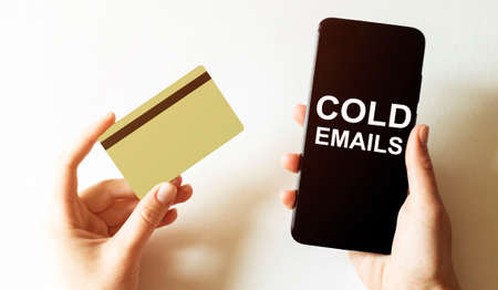 gold card and phone with text disaster recover plan Cold Emails in the female hands Stock fotó