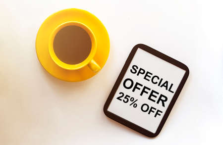 coffee and tablet with text Special Offer 25 Percent Off on the white background