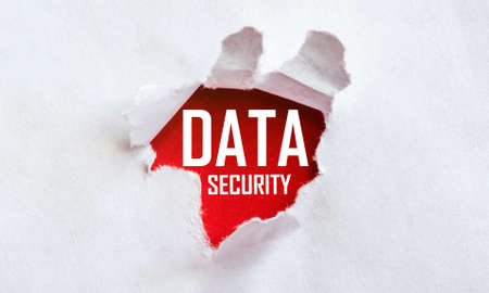 white torn paper with text Data Security on red background