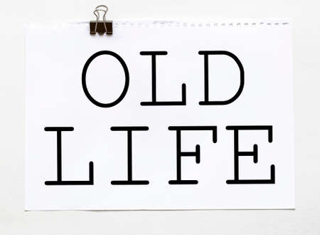 white paper with text Old Life on a white background with stationery Foto de archivo