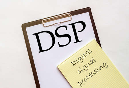 white and yellow paper with text DSP Digital signal processing on a white background with stationery